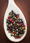 Mixed Red, Black and White Peppercorn in Wooden Spoon