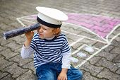 Little Preschool Child Having Fun With Ship Picture Drawing With Chalk