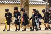 NARA,JAPAN, NOVEMBER 18, 2011: Japanese young students are coming back from elementary school in Nar