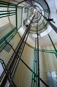 Spiral staircase with lifter rails in the Cap Frehel lighthouse, Brittany, France
