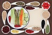 Large weight loss diet health food selection in porcelain bowls over parchment and brown paper backg