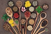foto of ginseng  - Liver detox super food selection in wooden bowls and spoons over brown paper background - JPG