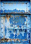 Massive Iron Door With Peeling Blue Paint