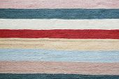 colorful striped grey fabric for background. oriental kelim carpet.