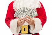 christmas, holidays, winning, currency and people concept - close up of santa claus with dollar money
