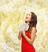 christmas, holidays, sale, banking and people concept - smiling woman in red dress with us dollar mo