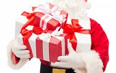 christmas, holidays and people concept - close up of santa claus with gift boxes