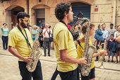 Young Musicians In The Street Of Tarragona