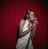 Young African woman with microphone
