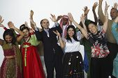 Multi-ethnic people in traditional dress cheering