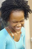Close up on young African woman laughing