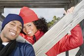 Multi-ethnic couple wearing winter clothing