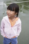 Asian girl with hands in pockets