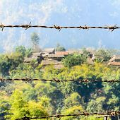 Barbed Wire And House Of Refugee Camps