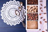 Wooden box with set of coffee and cocoa beans, sugar cubes on wooden background