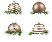 Colorful set of golden realistic christmas balls on snow with fir branches. Vector illustration.