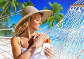 Woman applaying sun protection on skin.