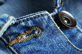 Button on clothes close up