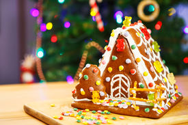 pic of gingerbread house  - Gingerbread house with Christmas tree and lights on background - JPG