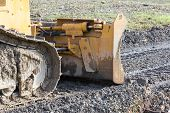 Closeup Of Tracked Loader Excavator At Construction Area