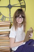 Girl In Glasses With A Book In Hand..