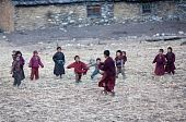 Peasants Children And Young Buddhist Monks Playing Soccer