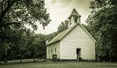 stock photo of primitive  - The Primitive Baptist Church in the Cades Cove valley is now a historical display in the Great Smoky Mountains National  Park - JPG