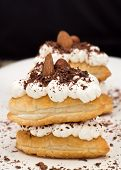 Puff pastry with cream and chocolate. vertical photo