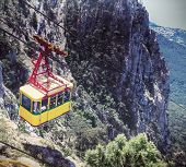 stock photo of ropeway  - Ropeway in Yalta leading to the top of Ai-Petri mountain. toning image