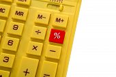 yellow calculator with red button
