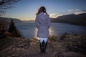 Woman Looks At A Lake