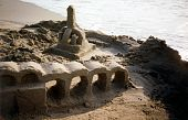 Sand Sculpture With Arches At The Beach