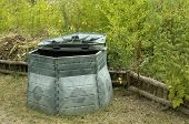 Compost Barrel In A Garden