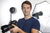 Male Professional Photographer Working In Studio