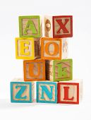 Colored Wooden Alphabet Blocks On White Background