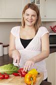 Pregnant Woman Chopping Up Fresh Vegetables