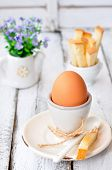 boiled egg for breakfast on a wooden table