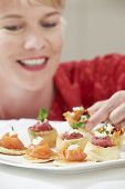 Woman Eating Appetizers On Plate