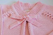Detail Of Pink Baby Blouse Made Of Tricot