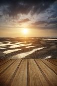 Beautiful Vibrant Summer Sunset Over Golden Beach Landscape With Wooden Planks Floor