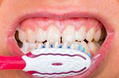 stock photo of toothpaste  - Close up photo of tooth brushing with toothpaste - JPG