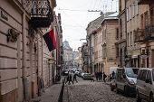 Lviv, Ukraine - February 23, 2015 Narrow Lviv Street With Combat Ukrainian Flag