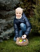 Smiling Girl Collecting Easter Eggs At Backyard