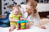 mother and kid playing block toys at home