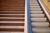 picture of escalator  - Full frame take of a staircase next to an escalator - JPG