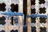 Old Wooden Door With Rusty Metal Hinge