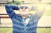 Attractive Old Man With Beard And Sunglasses