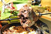 picture of frizzle  - large piece of meat is fried on skewer
