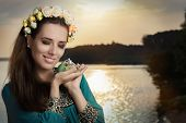 image of fragrance  - Portrait of a glamorous woman with retro fragrance recipient in seaside landscape - JPG