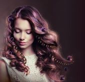 foto of flowing hair  - Beauty Portrait of Young Woman with Flowing Hairs - JPG